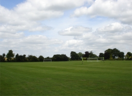 Football pitch and volleyball net